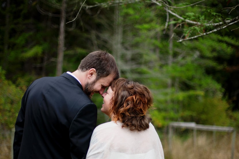 happy bride and groom portrait on pender island