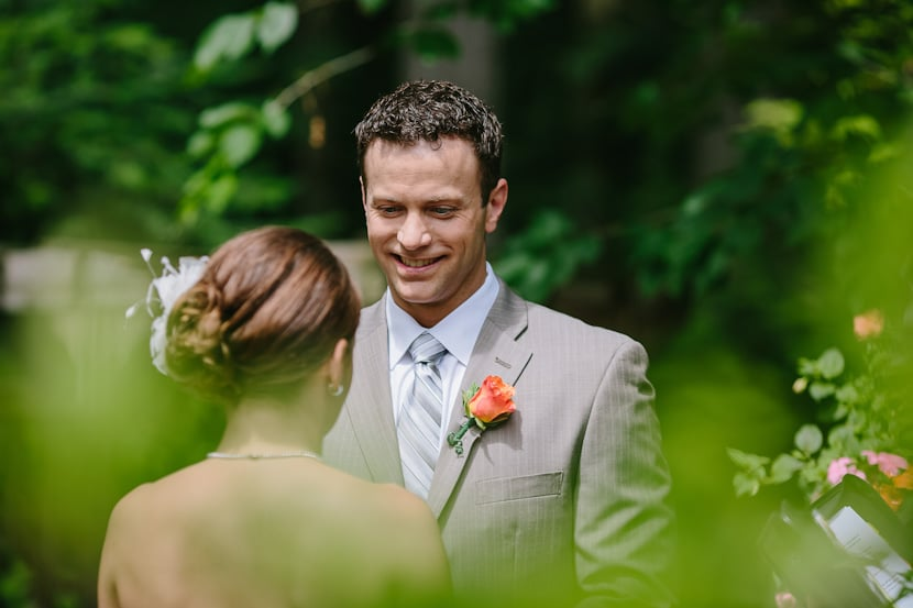 groom during backyard wedding ceremony in victoria, bc